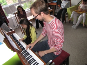 Student performs piano duet